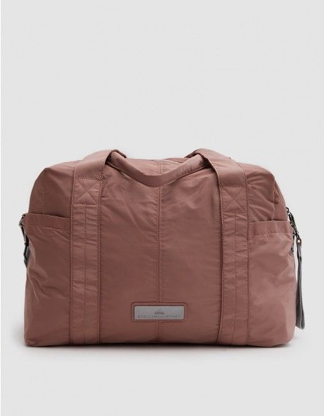 new concept 6b224 80531 Duffel bag from Adidas by Stella McCartney in Burnt Rose. Two top handles.  Removable adjustable shoulder strap. Dual exterior side pockets. Top zip  closure.