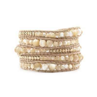 Alessandra Ambrosio style. Natural Mother of Pearl Graduated Wrap Bracelet on Beige Leather. View this product here http://wheresthatstyle.com/products/12295-natural-mother-of-pearl-graduated-wrap-bracelet-on-beige-leather
