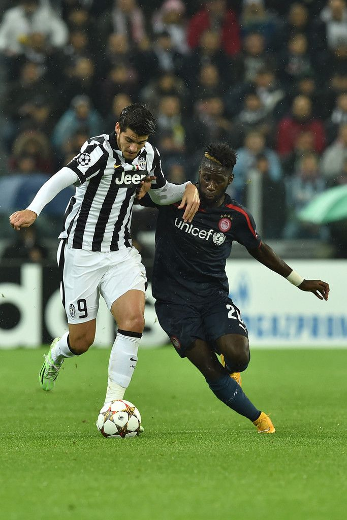 Alvaro Morata (L) of Juventus competes with Arthur Masuaku of Olympiacos FC during the UEFA Champions League group A match between Juventus and Olympiacos FC at Juventus Arena on November 4, 2014 in Turin, Italy.