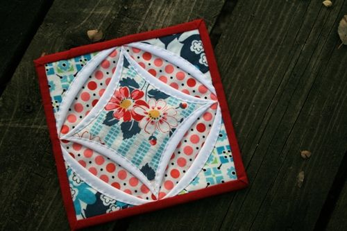 very cool variation of a Cathedral window quilt block