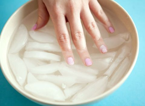 Fill a bowl with ice and water, and soak your nails for a few minutes after painting them. The cold water will set the paint and help your nails dry faster.