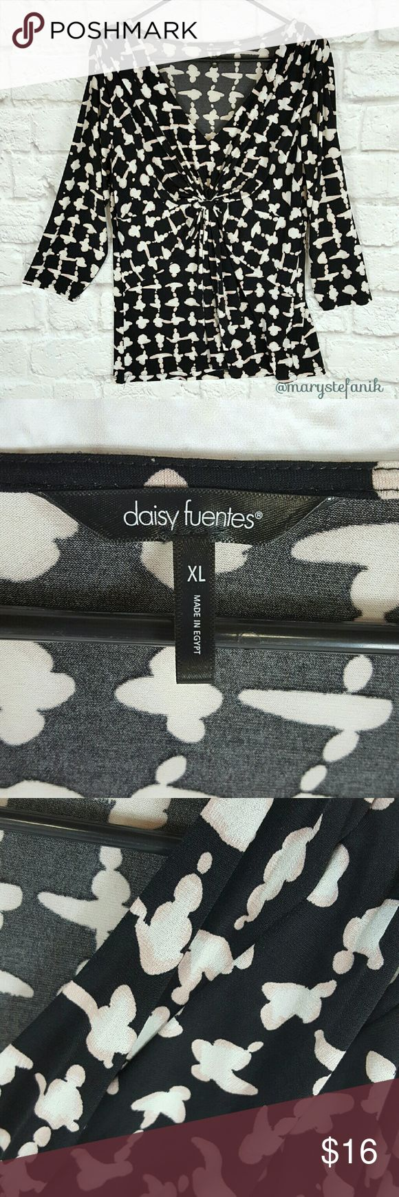 """Daisy Fuentes V Neck Stretchy Blouse Top size xL Daisy Fuentes V Neck Stretchy Blouse Top size xL in great used condition. Some very minor pilling. 95% Polyester, 5% Spandex.   Waist from Seam to Seam: 18"""" Length from Top: 27""""  Please let me know if you have any questions. Happy Poshing! Daisy Fuentes Tops Blouses"""
