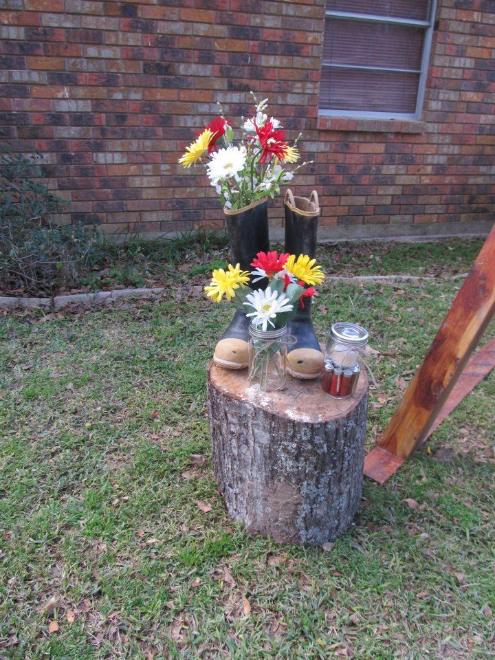 My husband cut the stumps for me.  I used his firefighter boots.  Dropped flowers in one boot.  Put a mason jar with flowers in it & another mason jar with a candle in it.  I used the small candles from Walmart that are in glass jars so we could reuse the mason jars after the wedding to drink out of & did not have to clean out the wax.