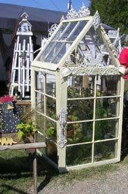 Look what you can make with some old windows and some salvaged  shabby chic bric-a-brac!!  A stately mini greenhouse for seed starting, small plants or specialty varieties!!  Wow!!