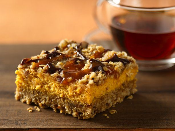 Pumpkin Streusel Cheesecake Bars. Chocolate and caramel drizzles add a new flavor punch to creamy pumpkin-oat bars.