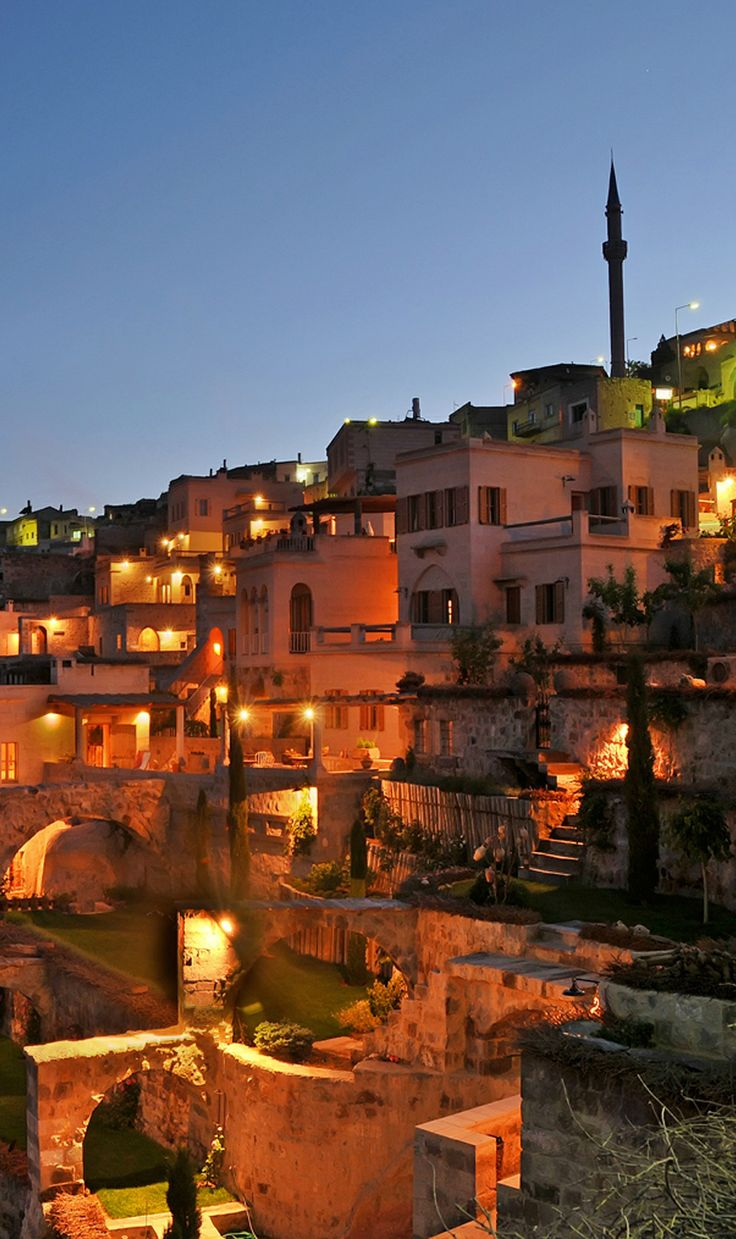 Cappadocia, Turkey's ancient cave dwellings and stone churches are romantically lit at night.