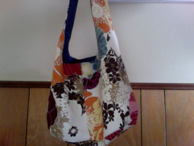 Hobo bag I made for my daughter. Funky pattern on outside, denim on inside. Easy to make, quick. I thought the strap was kinda short, but my daughter likes it so she can wear it like a messenger bag on her bike. http://blog.lulalouise.com/2008/01/reversible-shoulder-bag-tutorial.html