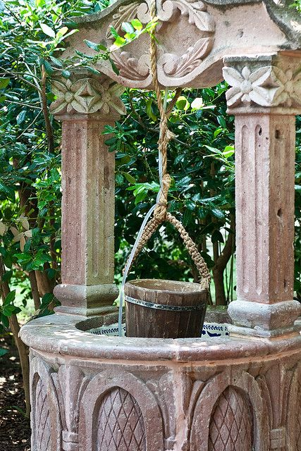 Sacred Well:  Wishing Well.  The tradition of tossing coins into wishing wells derives directly from the practice of ancient peoples to make offerings to the Gods and the Goddesses at Sacred Wells.