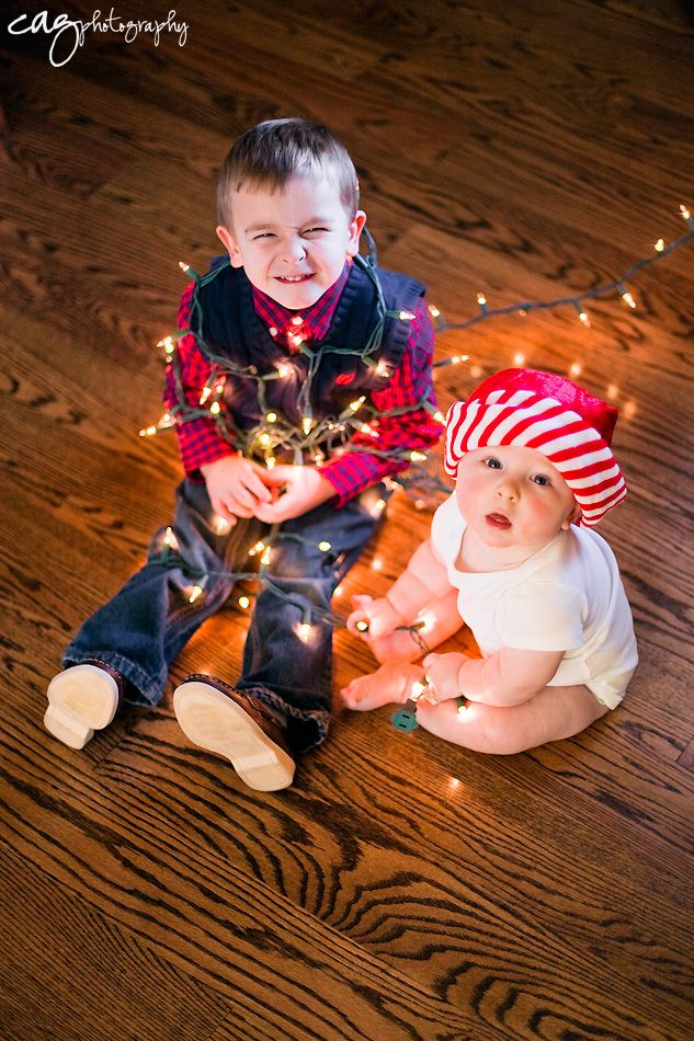 6 month old session - older brother wrapped in lights - siblings - christmas - CAG Photography