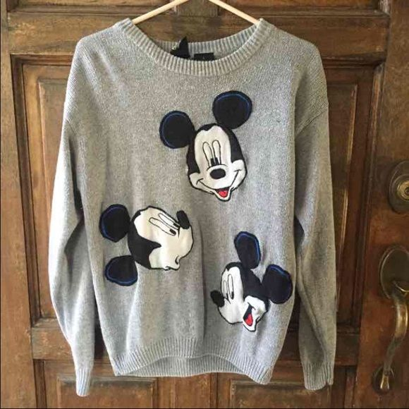 Vintage Mickey Mouse Sweater Vintage Mickey Unlimited Mickey Mouse print sweater. It is grey and has three vintage Mickey faces on the front. It is a size small but could fit a size small/medium. Selling just because I never wear it and have so many other clothes/Disney sweaters. It is rare. The ONLY other one I have seen is going for $62 plus shipping on Etsy. It is a size small and is in great vintage condition. No major wear. If you have any questions please ask! No trades, holds, or free…