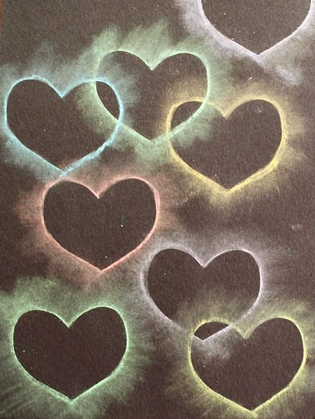 Heart collage made with chalk and stencils- looks like glowing hearts! Fun Valentines's Day craft for kids! ~ BuggyandBuddy.com