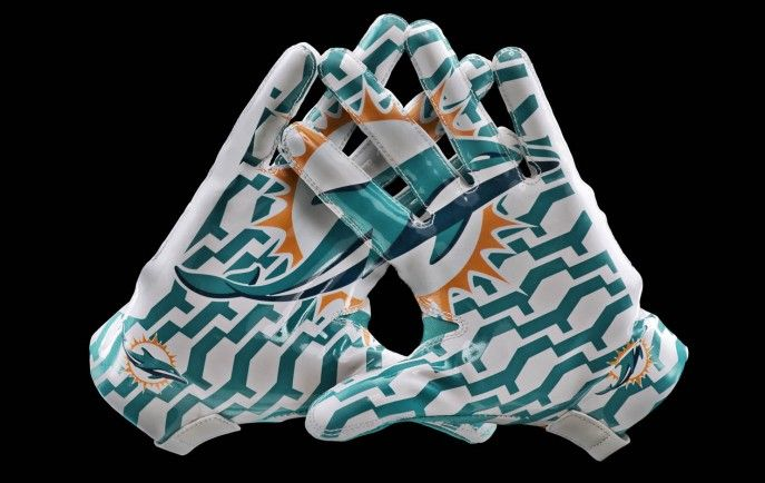 new 2013 Nike Miami Dolphins football uniforms gloves 2 687x434 Miami Dolphins Unveil New 2013 Nike Uniform Design