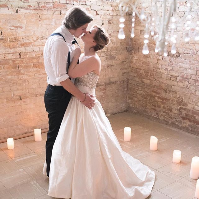 Beautiful white pillar candles encircling couple during a vintage wedding photoshoot with