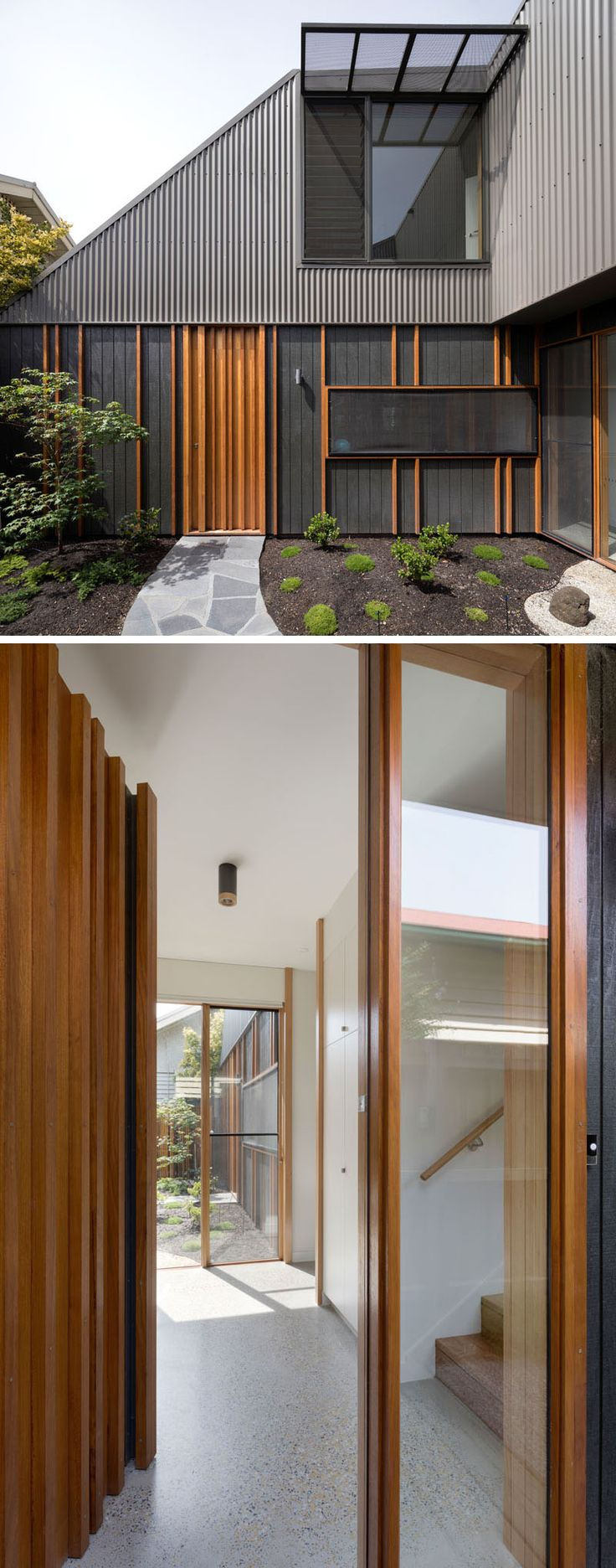 This modern house has hardwood battens that conceal joints in the cladding add texture to the facade, and allow the front door to blend in with the exterior. #ModernHouse #WoodFrontDoor #HouseDesign #Architecture