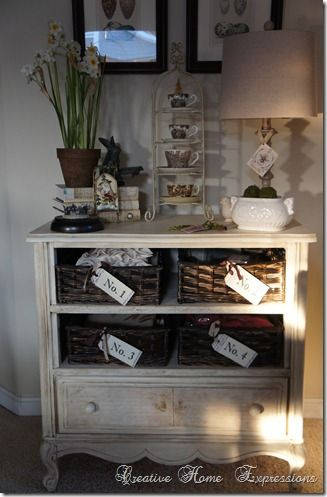 Find an old dresser missing some drawers? Remove the slides, replace with plywood, and insert baskets - voila! via Creative Home Expressions' blog...