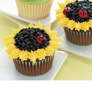 Sunflower: Using a small star tip and yellow frosting, pipe flower petals around the edge of the cupcake. Pipe chocolate frosting in center; cover with mini chocolate chips. For the ladybug, pipe chocolate frosting on a red M for decoration.