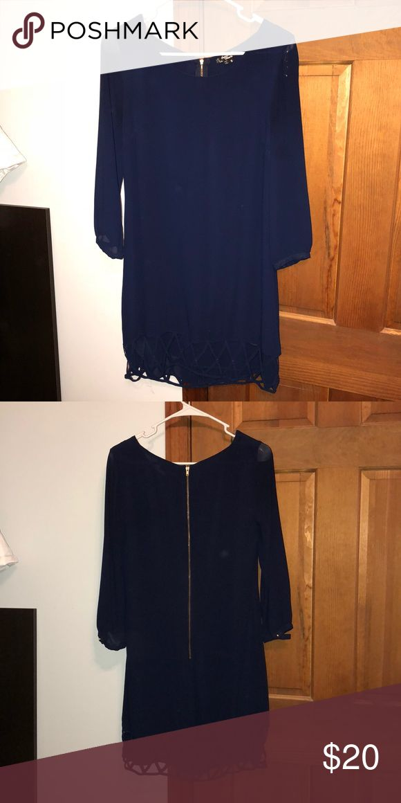 Navy, long sleeve dress Long sleeve, navy blue dress with cut outs on bottom (inner lining fillings in cut out design). 100% polyester. Worn minimal times, in excellent condition. Purchased from Von Maur! Sequin Hearts Dresses Long Sleeve