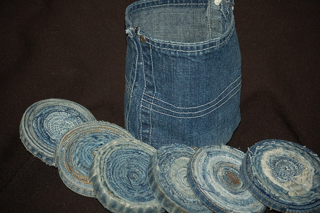 I liked recyclecindys denim coasters alot.  So I made a set of 6 along with a holder for them.  I just took to back pockets from a pair of jeans.  I cut the bottom of the pockets flat, sewed up the sides and sewed on a circle for the bottom.  I chose not to line it.