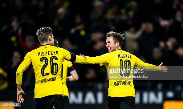 News Photo : Lukas Piszczek and Mario Goetze of Dortmund...