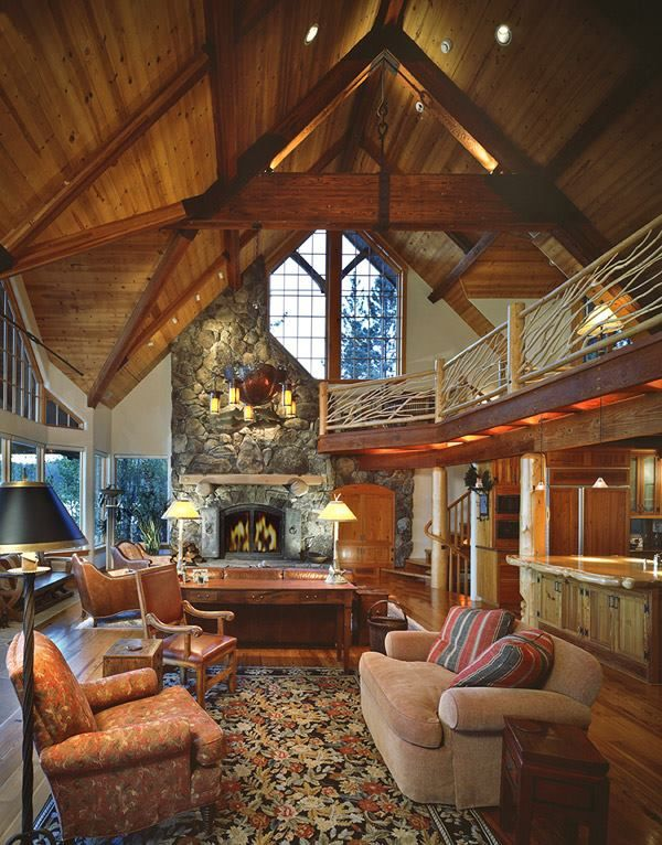 Log Home Living Room With Vaulted Ceiling And Fireplace