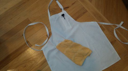 """Kitchen Apron (White) - Made in the USA of pre-shrunk durable 100% certified organic cotton - For men, women and chefs - apron sports breast pocket for thermometer and towel loop to keep a towel near you when cooking - extra long ties to tie in front - comes in black and white- Washes easily - Does not shrink or bleed. Great for BBQ's or cooking in the kitchen. Measures 28"""" x 32"""" P&J Products http://www.amazon.com/dp/B00I5QYQAG/ref=cm_sw_r_pi_dp_8f3Jtb1K6ERRTZ3M"""