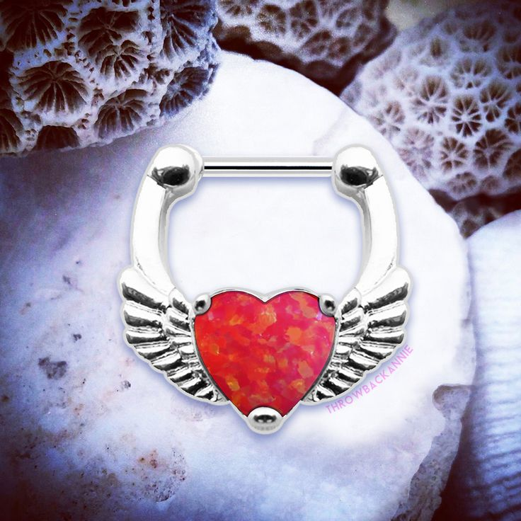 🌟🦄🌸  www.throwbackannie.com 🦄🌟💝Perf for you rock chicks this fierce red septum clicker is at the height of all septum jewellery this season! A silver winged septum ring that would look super cute paired with your street style! Take inspo from Zoe Kravitz and Lady Gaga and wear your septum piercing from sleek to sheek! Septum piercings are the ultimate fashion accessory this season so get your heart septum hoop from TBA instantly!