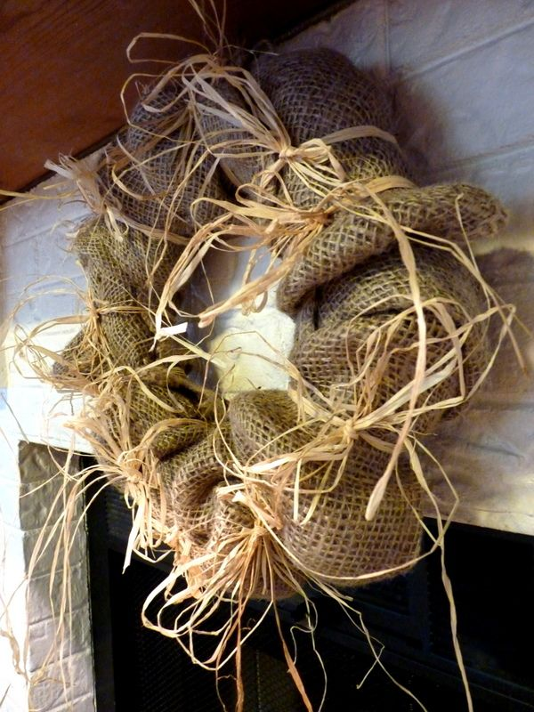 Cheap chic: Burlap (a couple of $1 feed sacks) and some rafia on a 15-inch wreath  form.