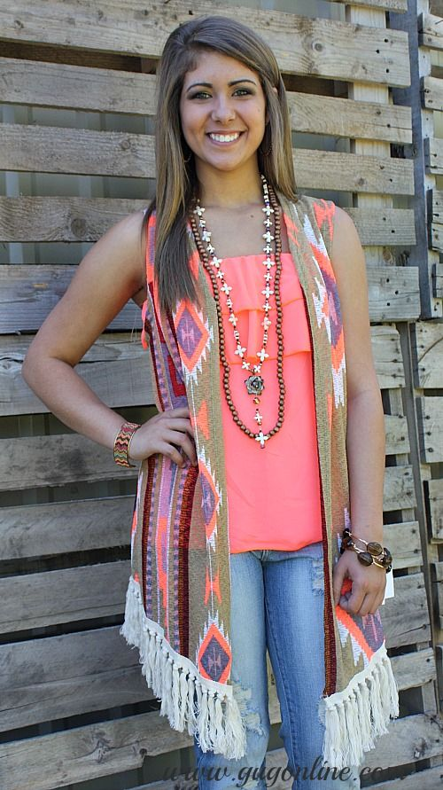 Strut Your Stuff Taupe and Neon Coral Aztec Vest with Fringe Small-Large $38.95 1XL-3XL $42.95 www.gugonline.com