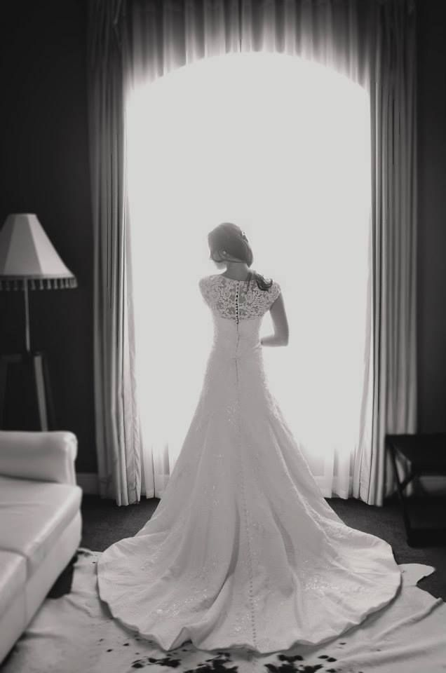 Striking from the back and front! This stunning wedding dress is designed by Oleg Cassini (available in South Africa exclusively at Bride&co) Style: WPD15110. Photo by Melissa Naudee Photography. Click to book a fitting in this dress. #brideandco #weddingsssouthafrica
