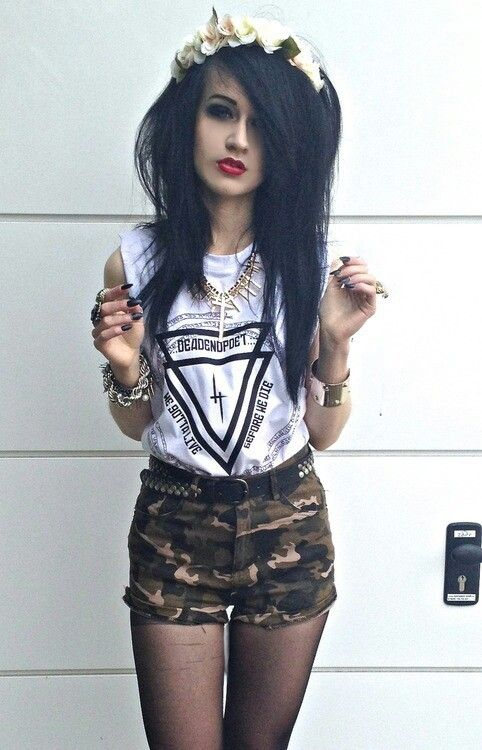 I really love her hair and makeup. I like the shirt too, not a huge fan of the shorts though..