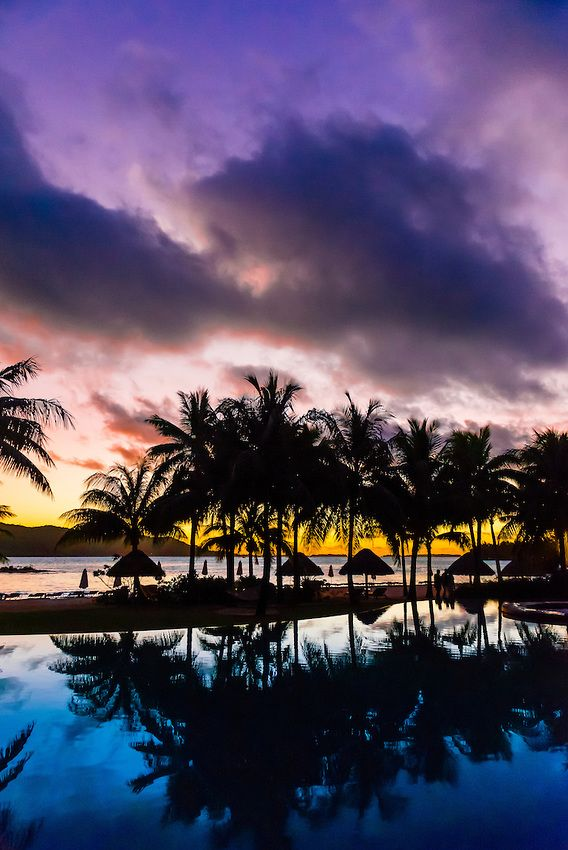 Reflection of palm trees into swimming pool, Four Seasons Resort Bora Bora on Motu Tehotu, Bora Bora, Society Islands, French Polynesia.