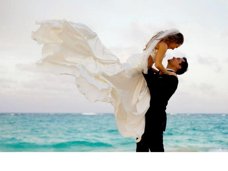 Fantastic beach wedding photo.