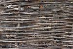 A traditional twig or wattle fence serves as an effective barrier while adding a touch of Old World charm to your property. If you have a rural property, chances are you can build a twig fence using materials you have on hand. Like standard wooden fences, twig fences use wooden posts as their structural supports. Rebar is sometimes used in place of...