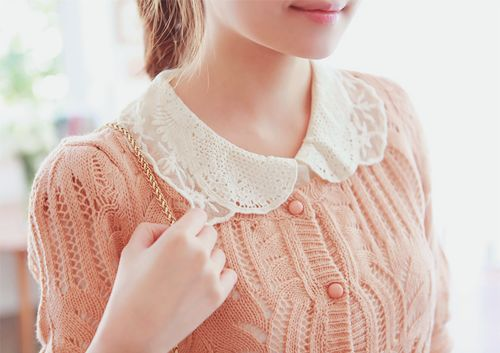 Cute pastel collared sweater.