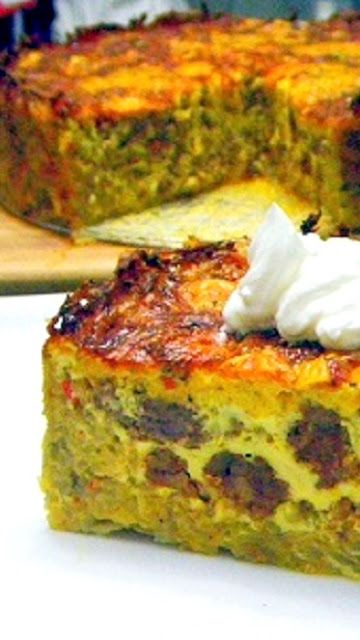 Quiche Cake with a Hash Brown Crust... BIG THICK DELICIOUS man sized QUICHE  Loaded with sausage and spices and even comes with a HASH BROWN crust!  Real men will LOVE this CAKE... Cake, it's not just dessert any more