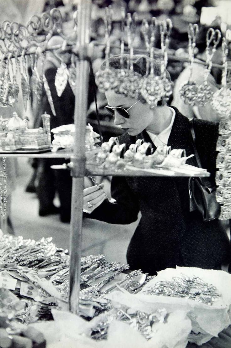 Shopping for silverware, Florence, Italy, 1950s  photo by Henri Cartier-Bresson