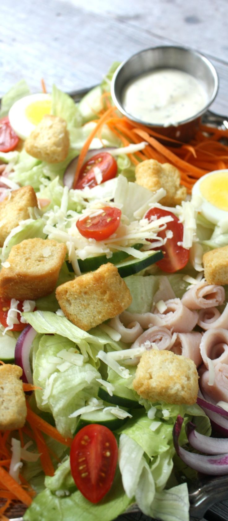 Chef's Salad is filled with crisp lettuce, fresh vegetables, deli meat and cheese. This entree sized Chef's salad is perfect for lunch or dinner.