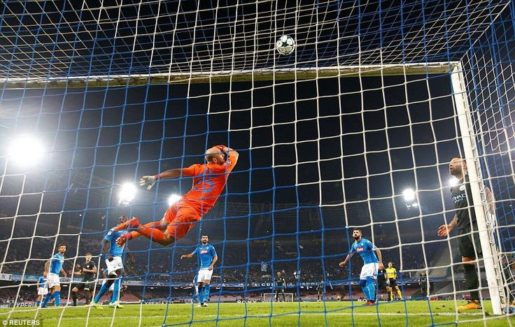 Napoli keeper Pepe Reina can only watch as Stones' first-half effort smacks back off the crossbar as City apply pressure