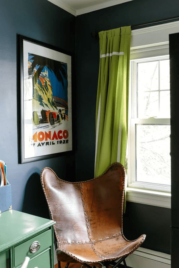 dark navy blue room with lime green curtains, chartreuse, pantone golden lime, leather sling chair, movie poster