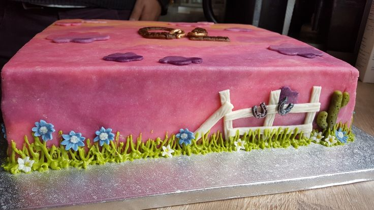 Western themed 70th birthday cake with vanilla sponge, strawberries, vanilla cream and marzipan decorations