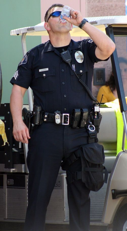 policeman drills blond guy