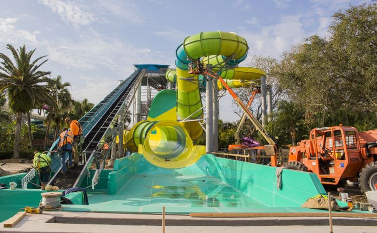 Workers at Adventure Island assemble the Tampa water park's newest thrill ride, called Colossal Curl, on Wednesday.
