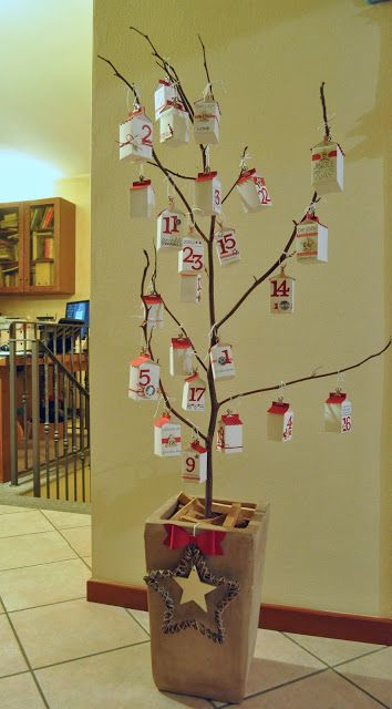 A unique Christmas advent tree. The kids would definately enjoy helping with this one. You could put a number on one side of the 'decoration'. A scripture on another side, a service idea on the third and maybe a picture on the fourth.