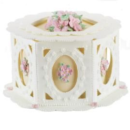 Nirvana Cameos Cake. A color flow framework draws the eye to botanical images created with royal icing. Use our patterns and piped-icing mortar to construct the gazebo-like overlay.