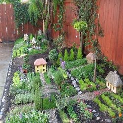 Herb garden village! Very fun and cute idea! Great to help get kids involved with gardening and growing your own fruit, veg and herbs!