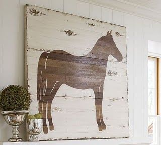 This blog shows how to make this by yourself!  I looove it!!! http://followyourheartwoodworking.blogspot.com/2010/11/black-horse-ranch-sign.html