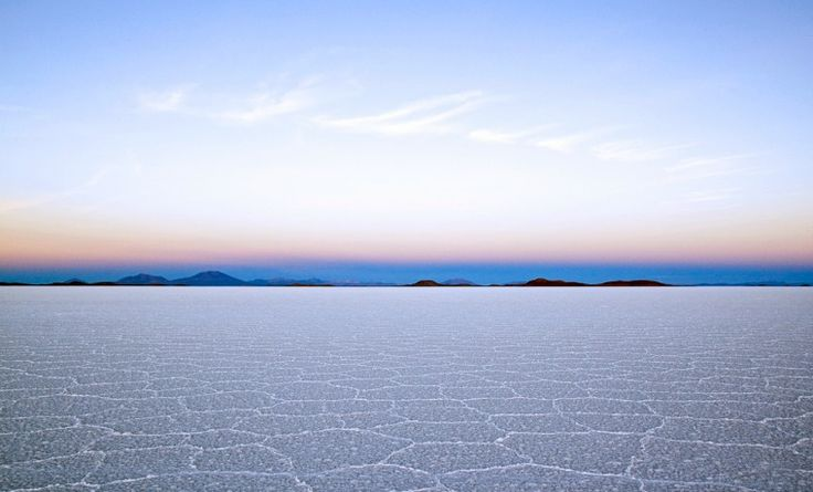 Salar De Uyuni is the biggest salt flat in the world, located in South West Bolivia.Its unique landscape makes it a photographic heaven and the surface reflects like a mirror post-rain.