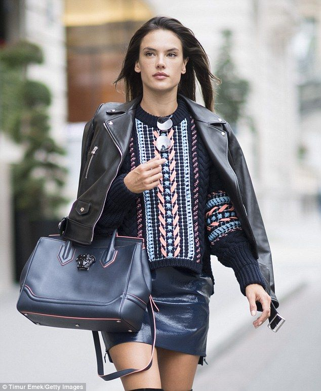 Leather mama: The 35-year-old IMG Model matched her blue leather mini-skirt with a $3K Versace Palazzo Empire FW/17 colorways bag