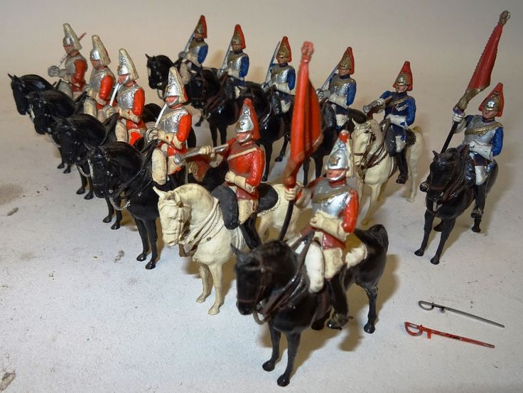 Lot 462 - Herald RARE FIRST VERSION mounted Household Cavalry on early cellulose acetate horses, four Life