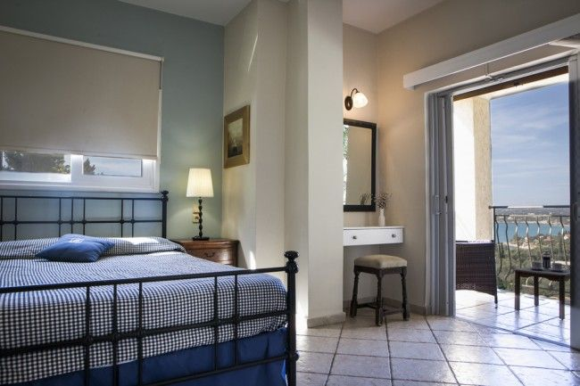 Upstairs, the double bedroom is worthy of special mention, as it boasts the unusual feature of a corner bath, again with a window that allows you to shower with superb sea views.